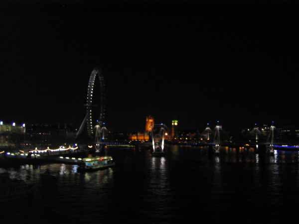 London at night across the Thames.